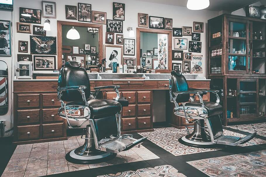 two-barbers-chairs-in-front-of-mirrors-inside-room